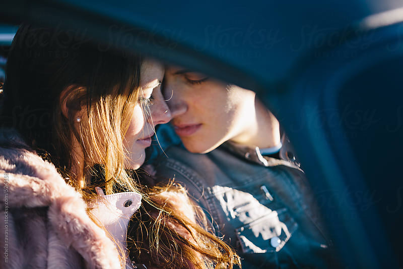 Intimate moment of a couple in the car by michela ravasio for Stocksy United