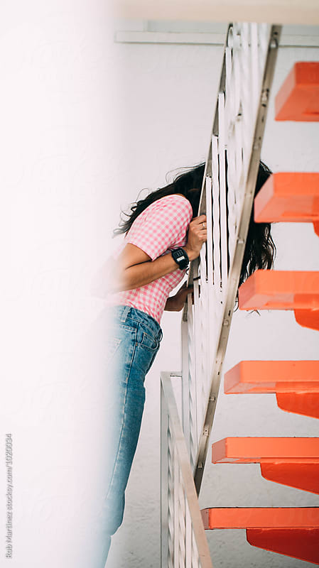Pink Stairs Girl by Rob Martinez for Stocksy United