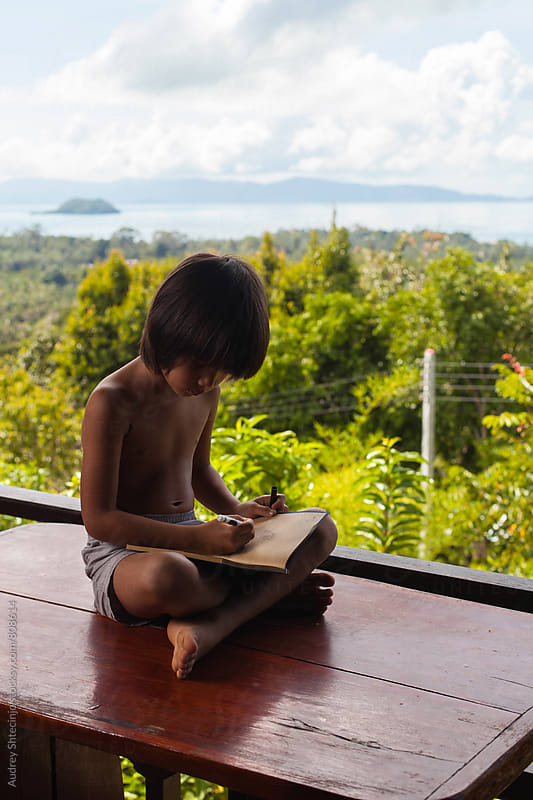 Cute kid learning at the middle of the wilderness/Thailand by Marko Milanovic for Stocksy United