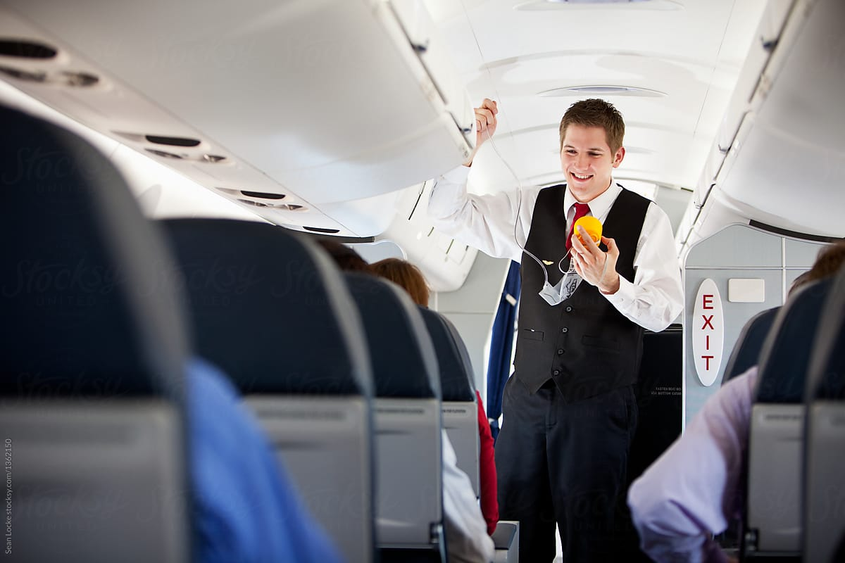 Stock Photo - Airplane: Attendent Demonstrates Oxygen Mask