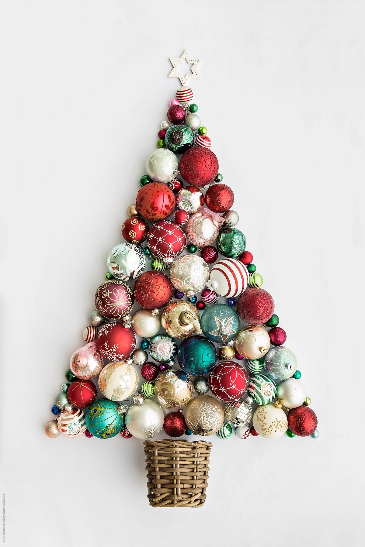 christmas tree made from christmas ornaments by ruth black for stocksy united