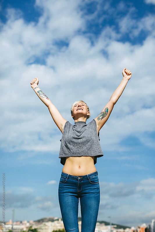 Happy young woman jumping and enjoying day. by BONNINSTUDIO for Stocksy United