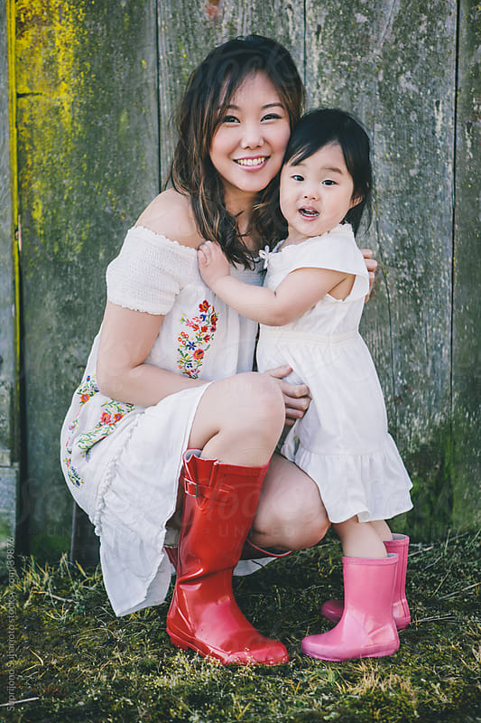 Asian mother and daughter by Suprijono Suharjoto for Stocksy United