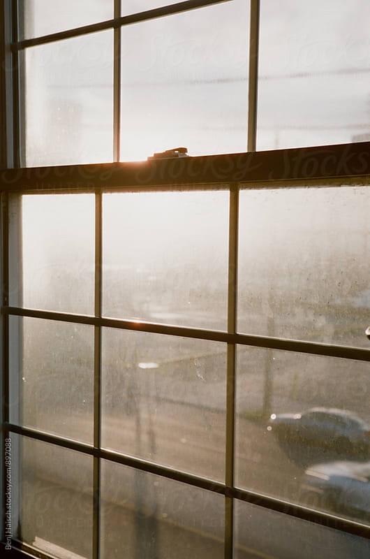 Sunset Through a Foggy Window by Benj Haisch for Stocksy United