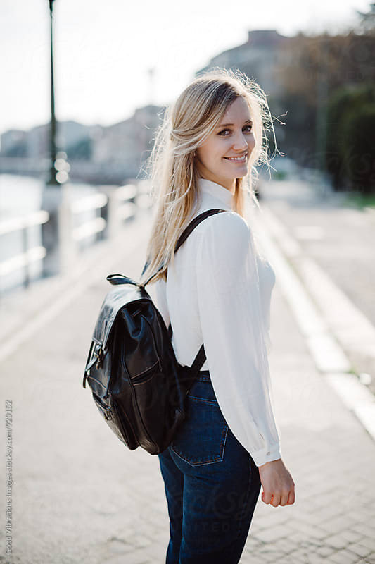 Beautiful blond woman in the city at sunset by Good Vibrations Images for Stocksy United