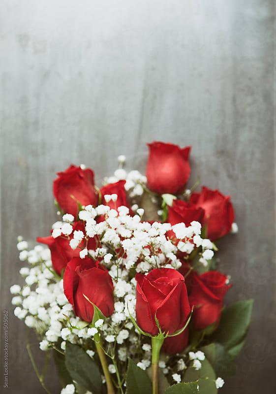 Valentine: Dozen Rose Bouquet On Grunge Metal Background by Sean Locke for Stocksy United