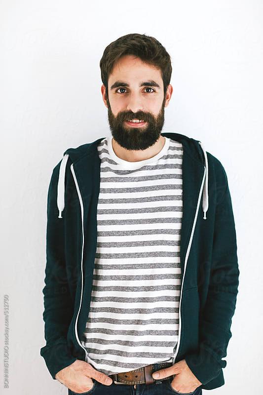 Young real bearded man portrait over white.  by BONNINSTUDIO for Stocksy United