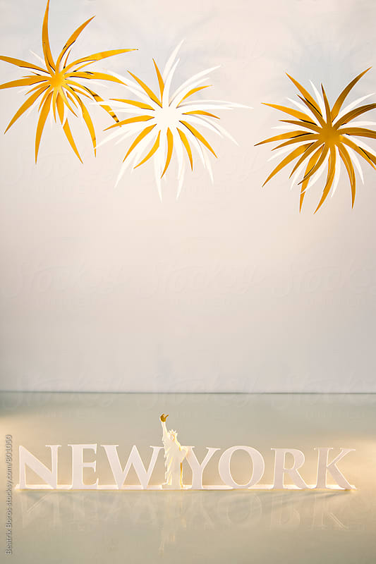New York text and Statue of Liberty on white with fireworks by Beatrix Boros for Stocksy United