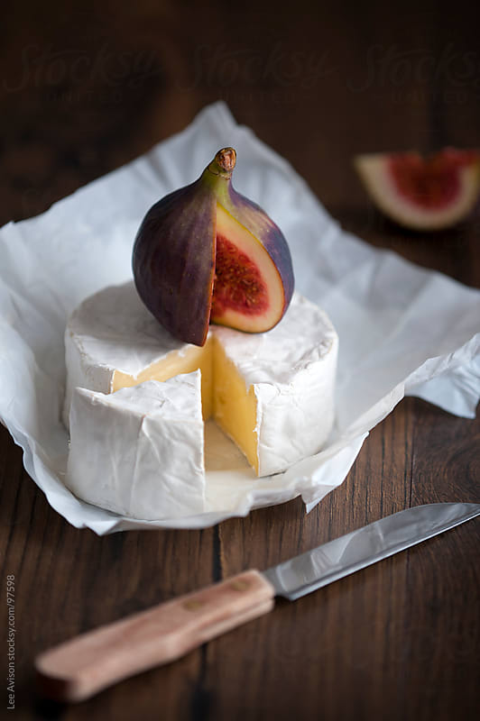 camembert cheese and fresh figs by Lee Avison for Stocksy United