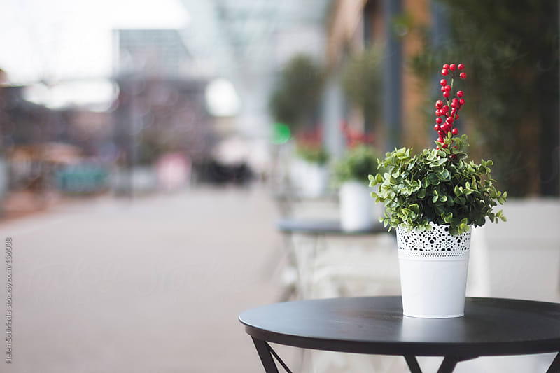 Outdoor Tables Decorated for Christmas by Helen Sotiriadis for Stocksy United