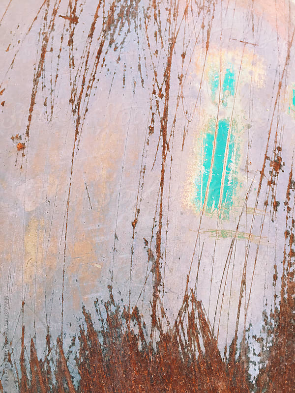 Detail of rust and scratch marks on painted metal door by Paul Edmondson for Stocksy United