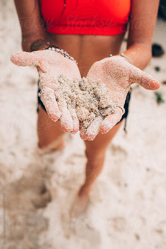 Sand between Fingers  by Studio Firma for Stocksy United