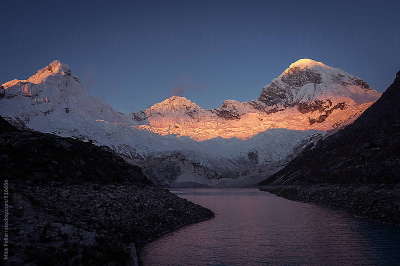 Sunset on high alpine peaks with glacier lake by Mick Follari for Stocksy United