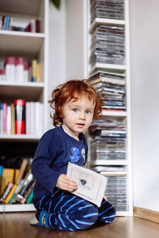 Little Redhead Toddler Kneeling On Floor by minamoto images for Stocksy United