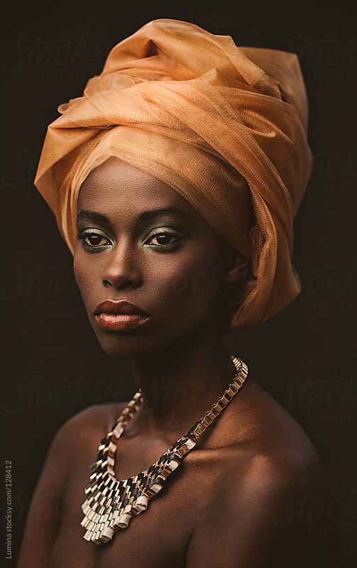African Woman With an Orange Turban by Lumina for Stocksy United