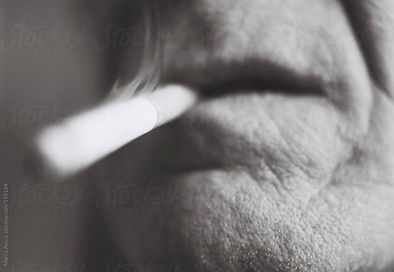 Old smoker by Marija Anicic for Stocksy United