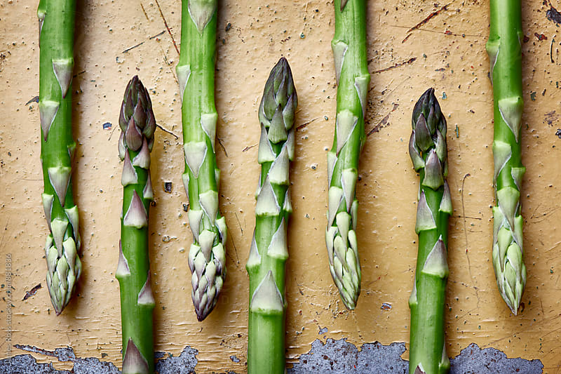 Seven sticks of asparagus by James Ross for Stocksy United