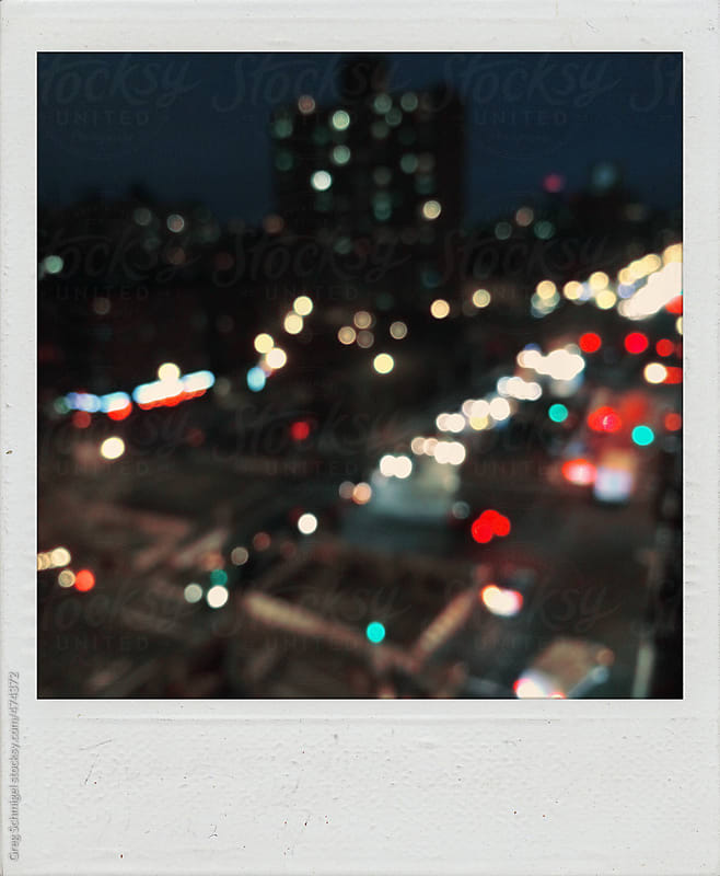 Old polaroid photographs night landscape view of New York City lights bokeh by Greg Schmigel for Stocksy United