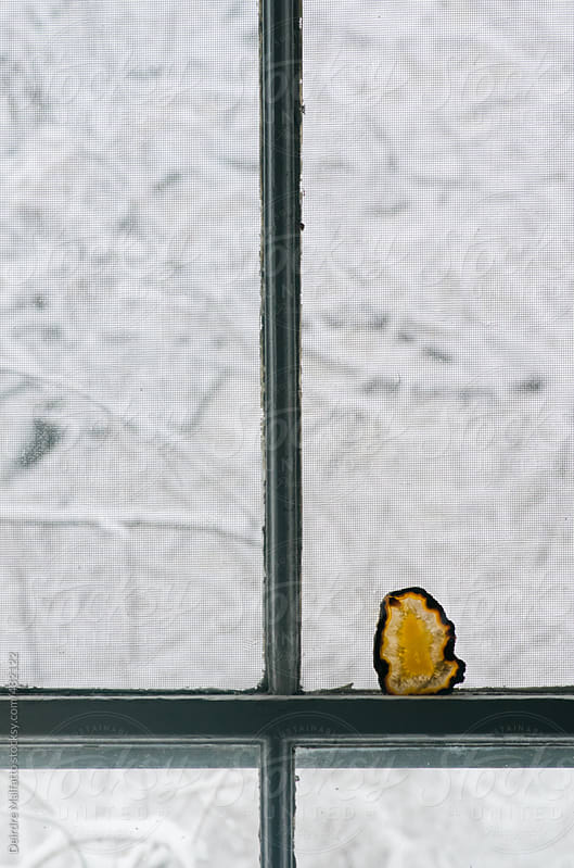 window looking out on a s snowy view by Deirdre Malfatto for Stocksy United