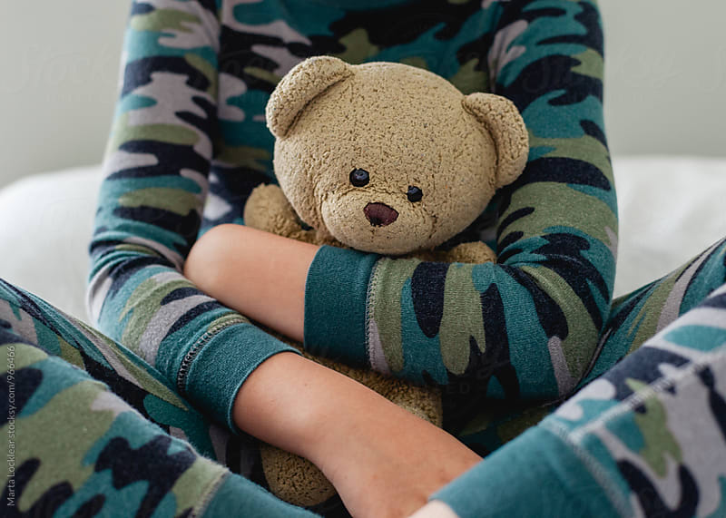 Boy holding his Teddy Bear by Marta Locklear for Stocksy United