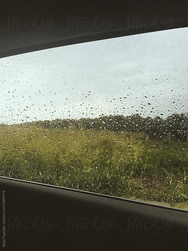Car window with rain drops by Maja Topcagic for Stocksy United