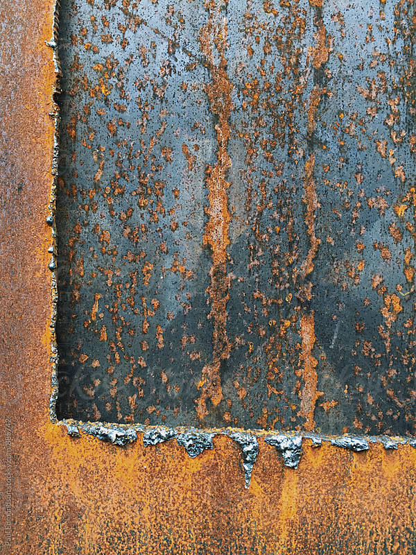 Close up of slabs of rusty steel  by Paul Edmondson for Stocksy United