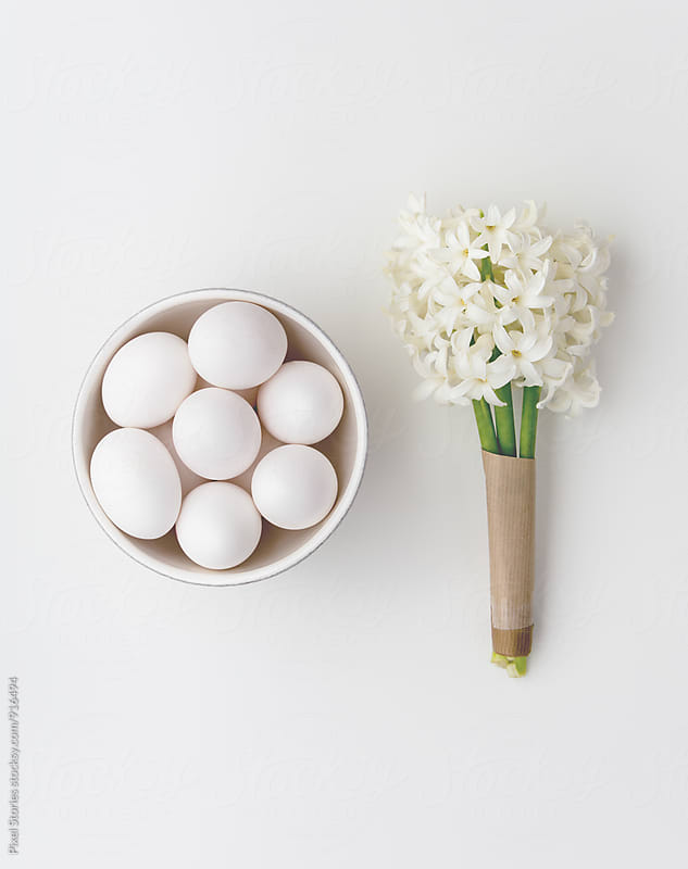 White eggs and white hyacinth by Pixel Stories for Stocksy United