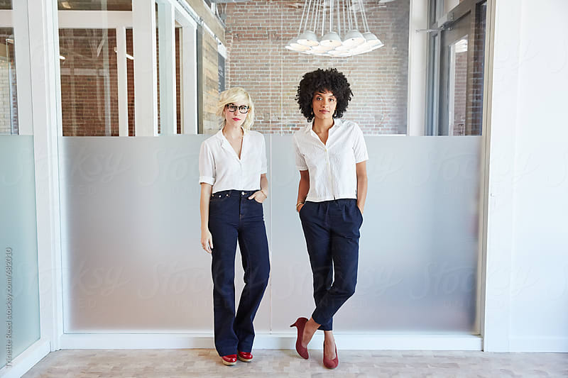 Portrait of millennial businesswomen in office by Trinette Reed for Stocksy United
