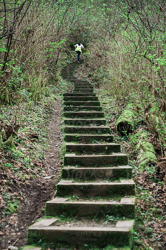 Woman Running Up Steep Stairs For Fitness by Ronnie Comeau for Stocksy United