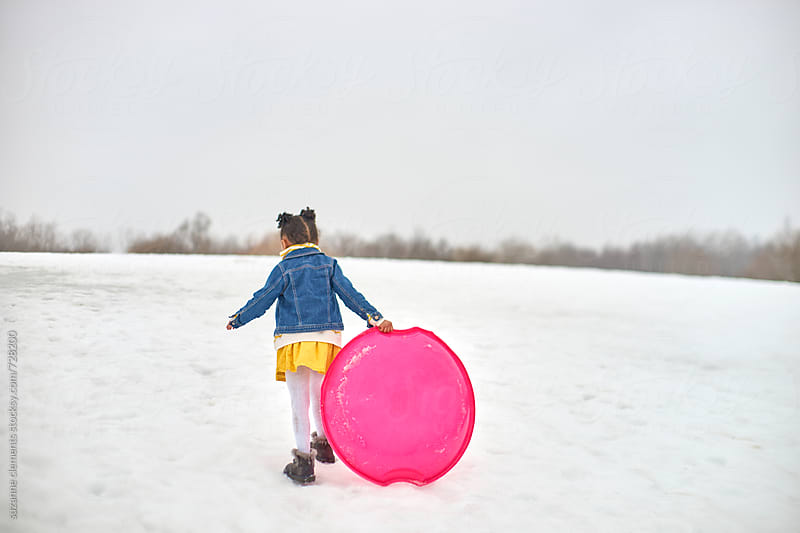 Winter Snow and Sledding Fun by suzanne clements for Stocksy United