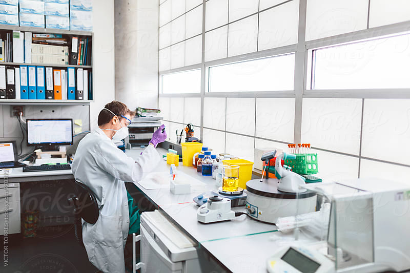Biologist Working in a Professional Laboratory by VICTOR TORRES for Stocksy United