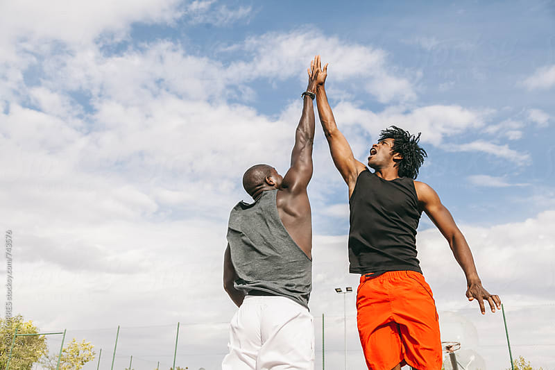Two Black Friends High Five in the Air by VICTOR TORRES for Stocksy United