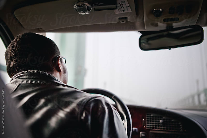 Man driving looking out his windshield by Kristine Weilert for Stocksy United