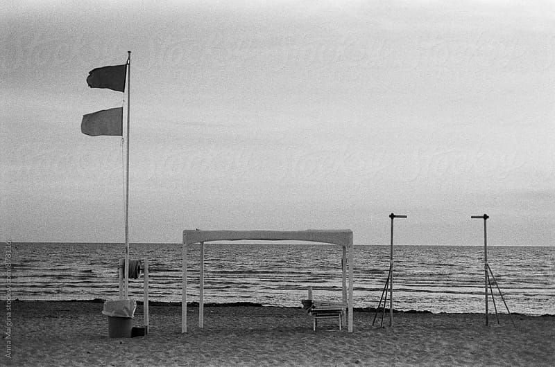 Black and white film photo of seaside in Italy  by Anna Malgina for Stocksy United