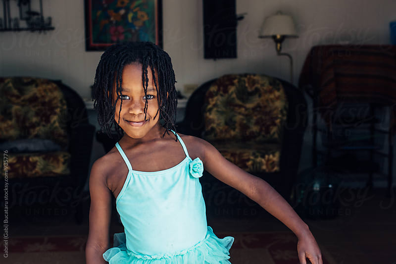 Black girl in a turquoise swimsuit by Gabriel (Gabi) Bucataru for Stocksy United