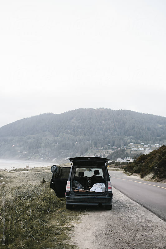 car parked on the coast for camping by Nicole Mason for Stocksy United