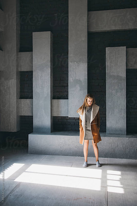 Girl standing in front of abstract wall by Danil Nevsky for Stocksy United