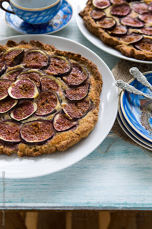 Fig frangipane galette on a table by Aniko Lueff Takacs for Stocksy United