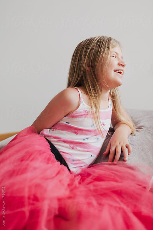 Happy Blonde Girl in a Pink Skirt by Lumina for Stocksy United
