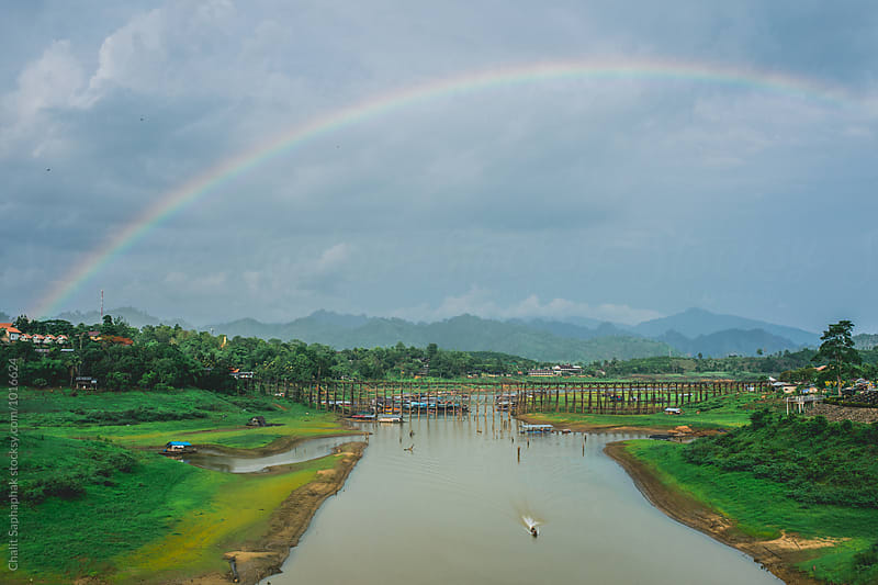 Rainbow on the bridge by Chalit Saphaphak for Stocksy United