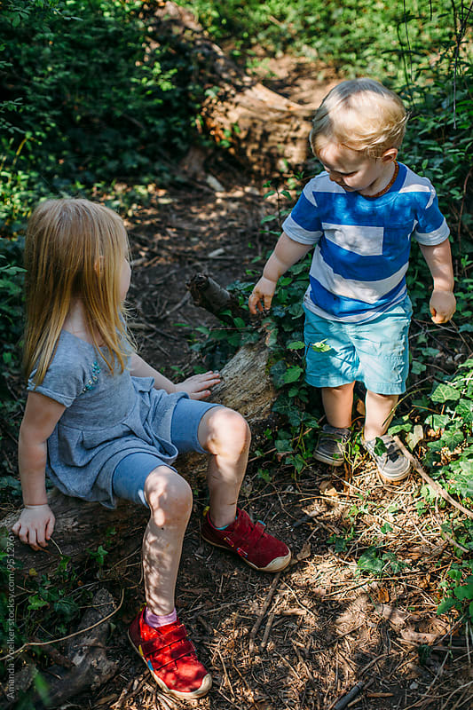 Two Young Children On a Wooded path by Amanda Voelker for Stocksy United