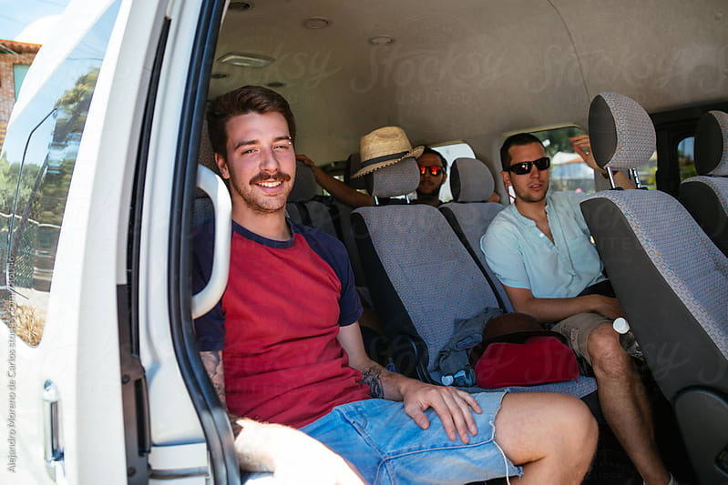 Group of young men sitting inside a van ready for a road trip by Alejandro Moreno de Carlos for Stocksy United