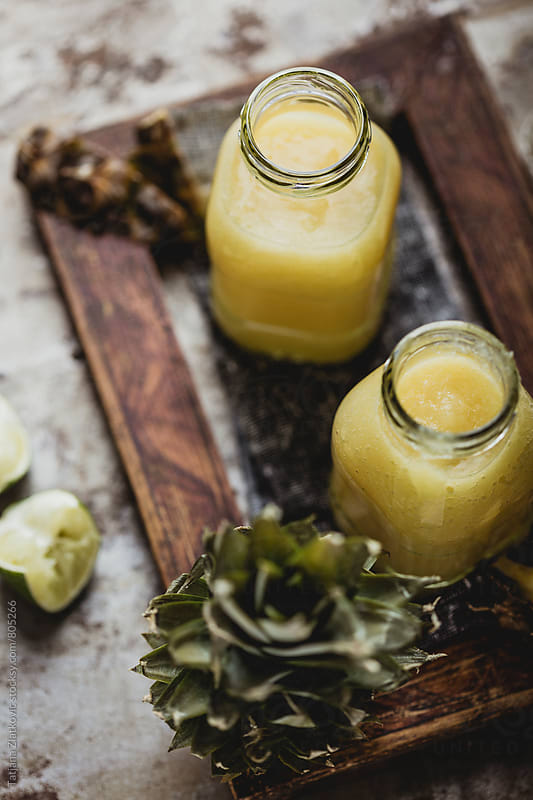 Pineapple smoothie by Tatjana Ristanic for Stocksy United