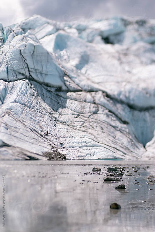 rocks leading to a glacier by Tara Romasanta for Stocksy United