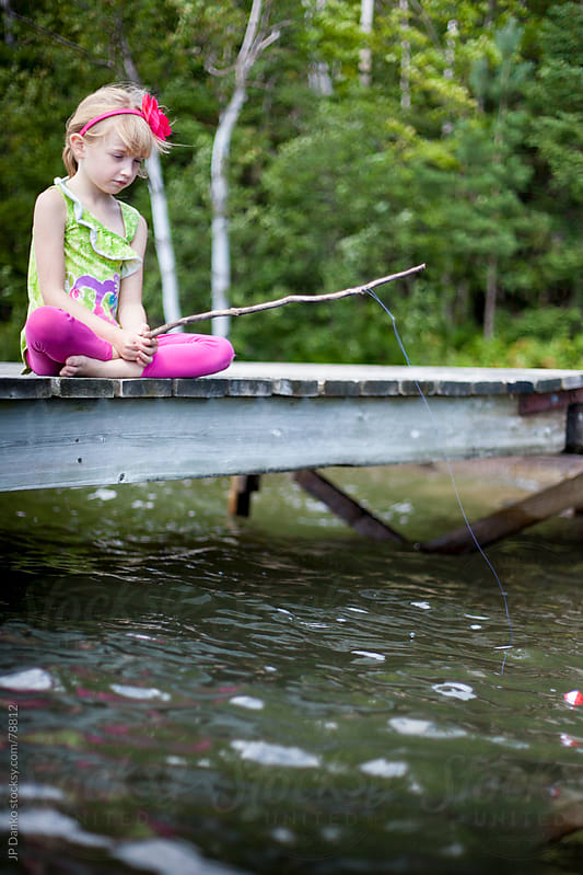 Little Girl Fishing With Worm From Cottage Lake Dock by JP Danko for Stocksy United