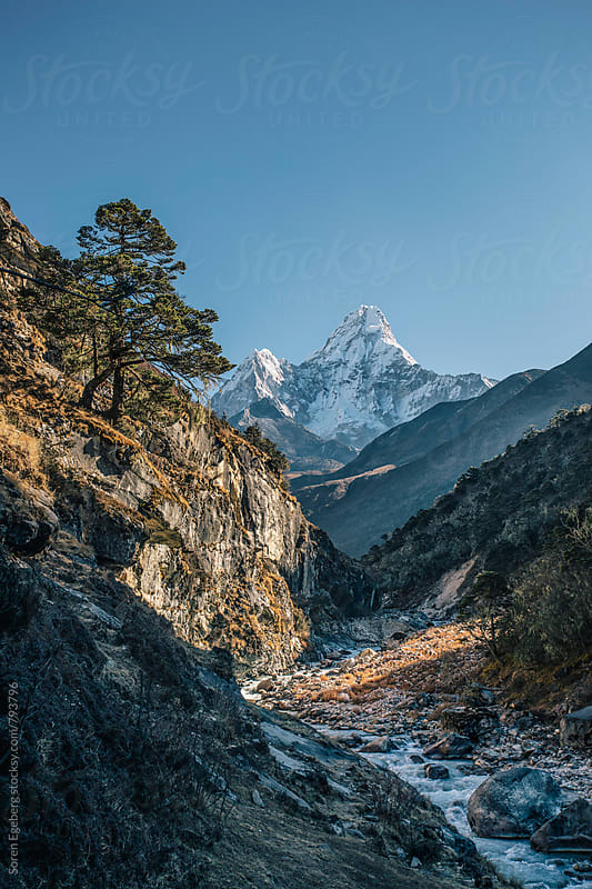 Deep Himalyan valley with Mt. Ama Dablam on the Everest trail, Everest region by Søren Egeberg Photography for Stocksy United