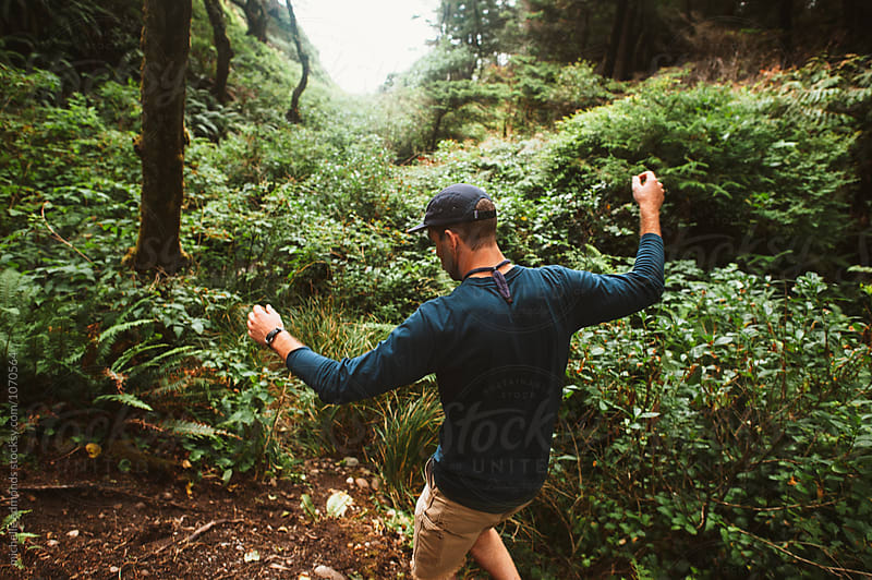 Young Man Hiking on the Pacific Coast by michelle edmonds for Stocksy United