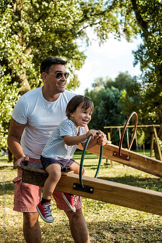 Dad and Son Playing at the Park by Aleksandra Jankovic for Stocksy United