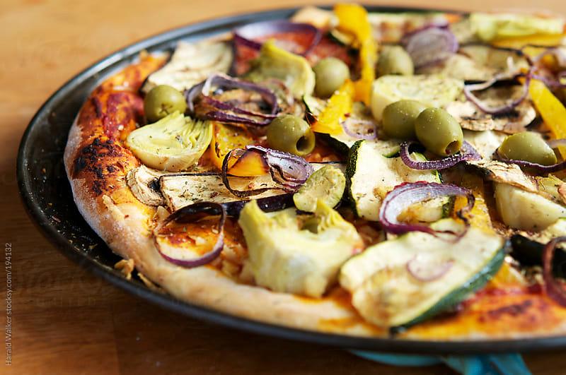 Mediterranean vegan pizza by Harald Walker for Stocksy United