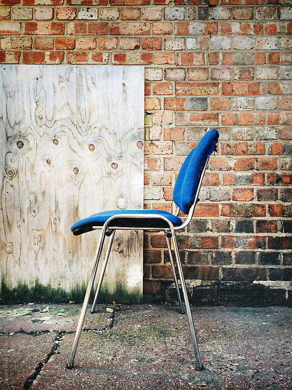 A chair left on the pavement by James Ross for Stocksy United